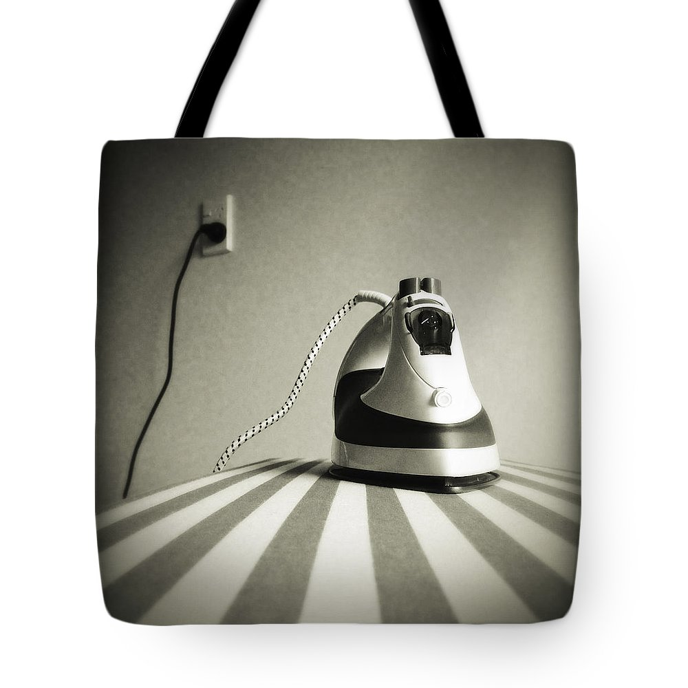 Retro Tote Bag featuring the photograph Iron by Les Cunliffe