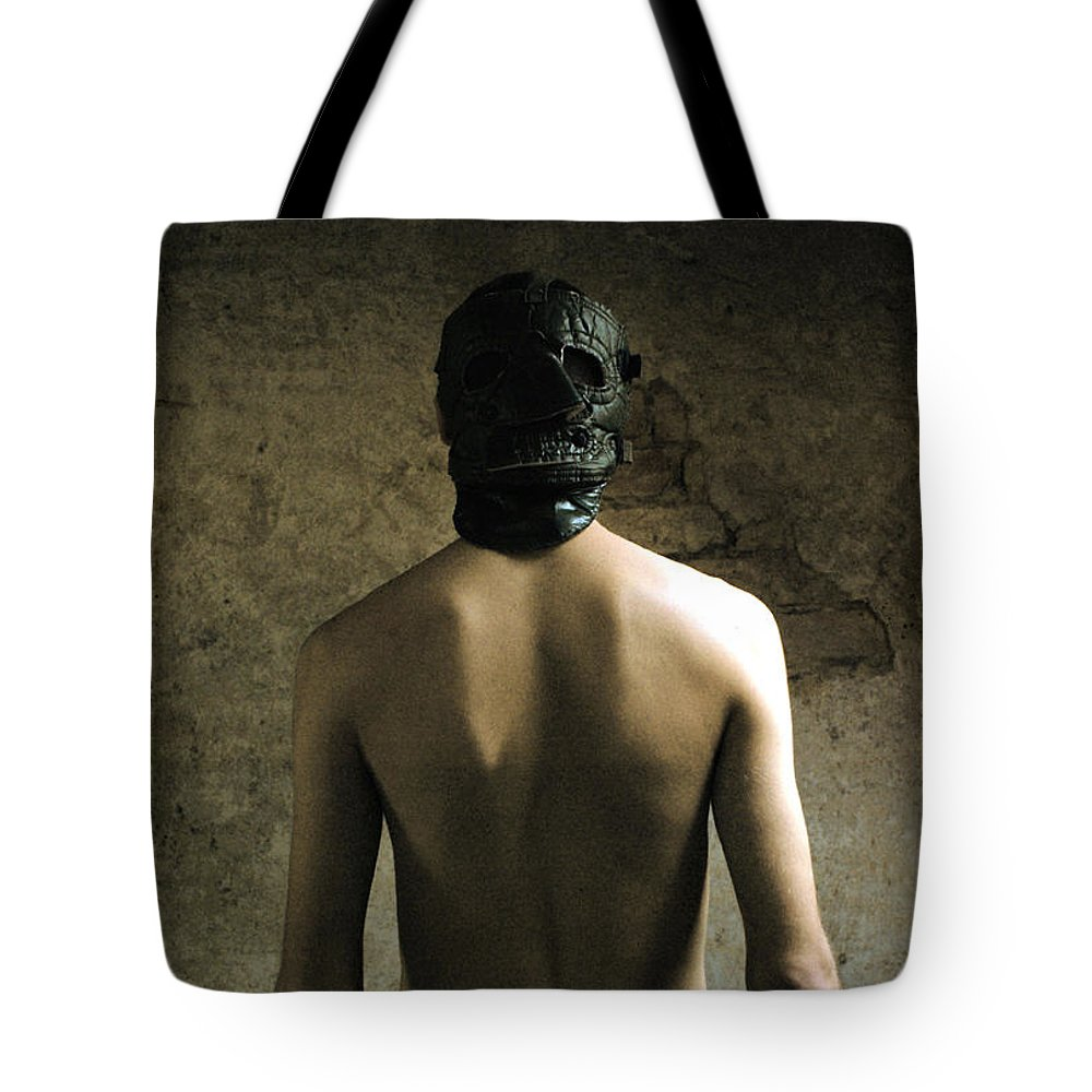 Dark Tote Bag featuring the photograph Irrefutable by Pawel Piatek