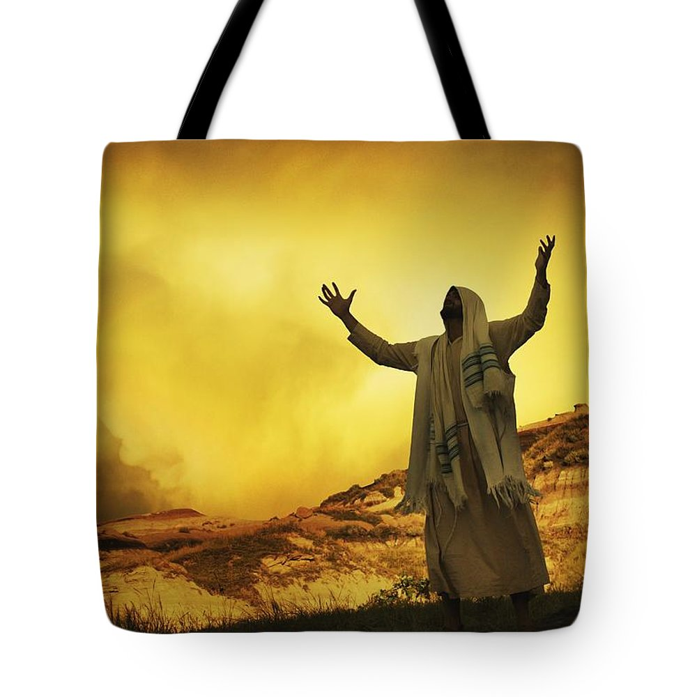 Outdoors Tote Bag featuring the photograph Jesus With Arms Stretched Towards Heaven by Don Hammond