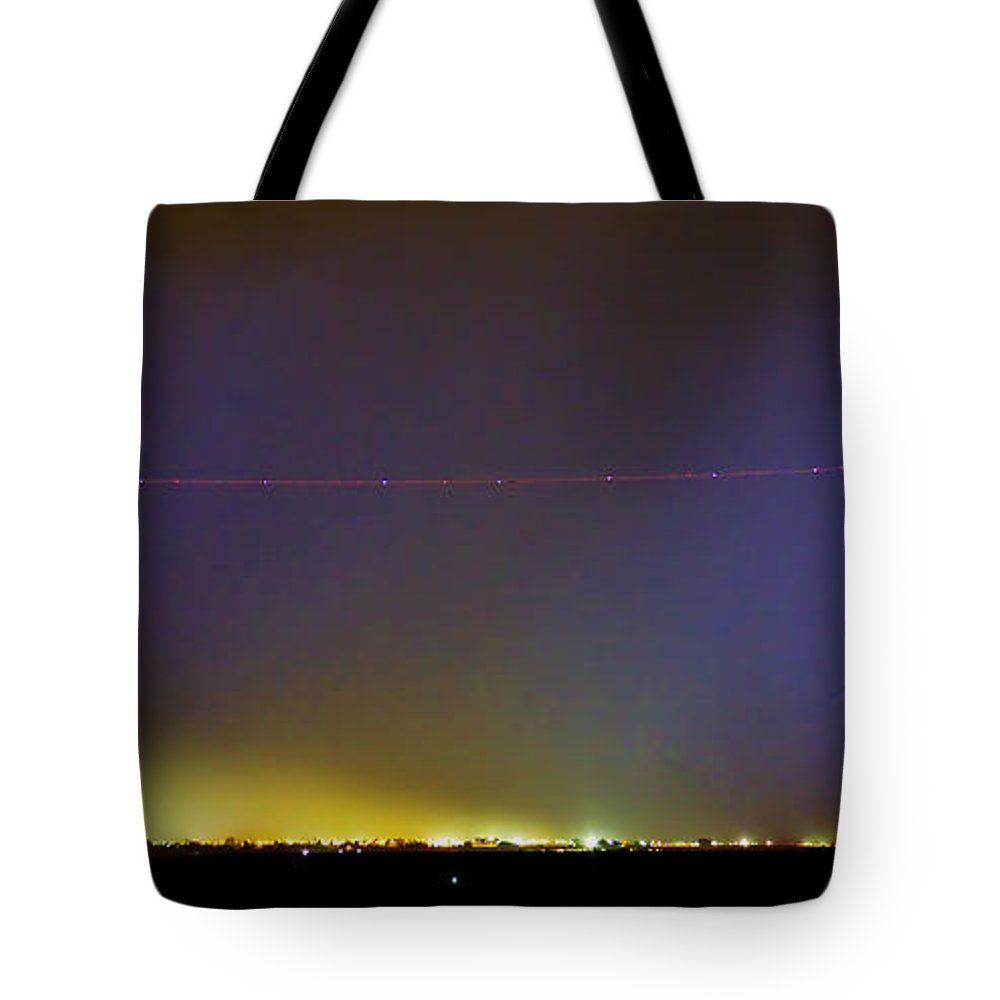 Lightning Tote Bag featuring the photograph Jet Over Colorful City Lights And Lightning Strike Panorama by James BO Insogna