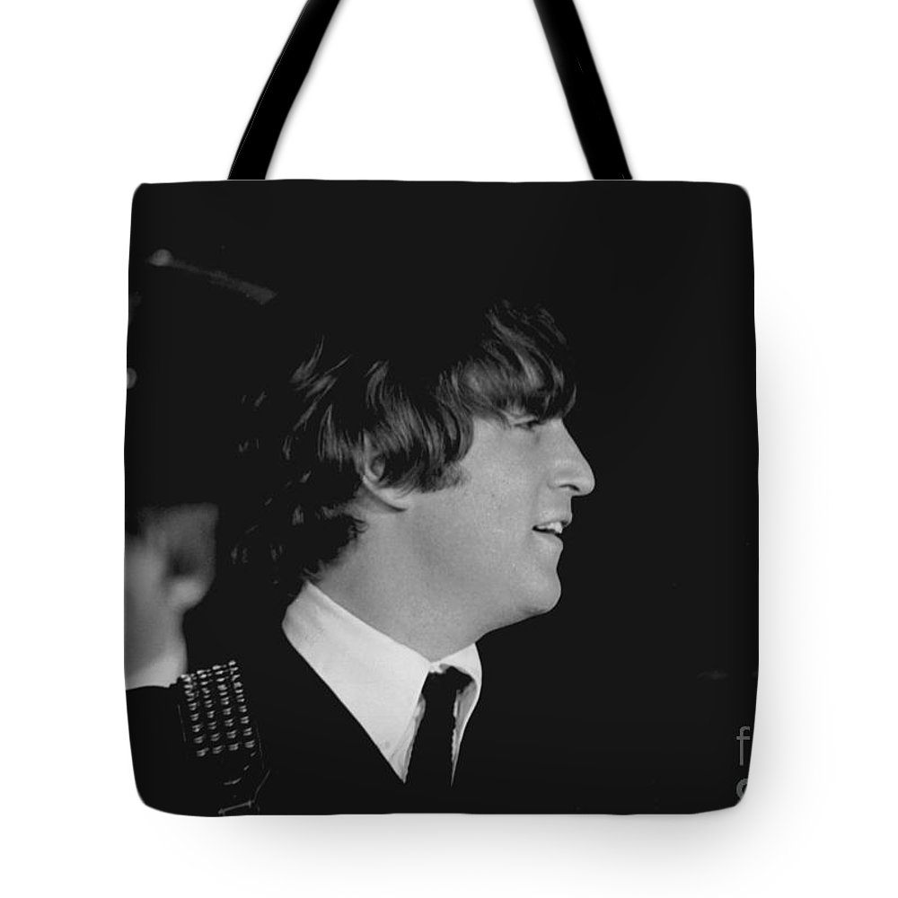 Beatles Tote Bag featuring the photograph John Lennon, Beatles Concert, 1964 by Larry Mulvehill