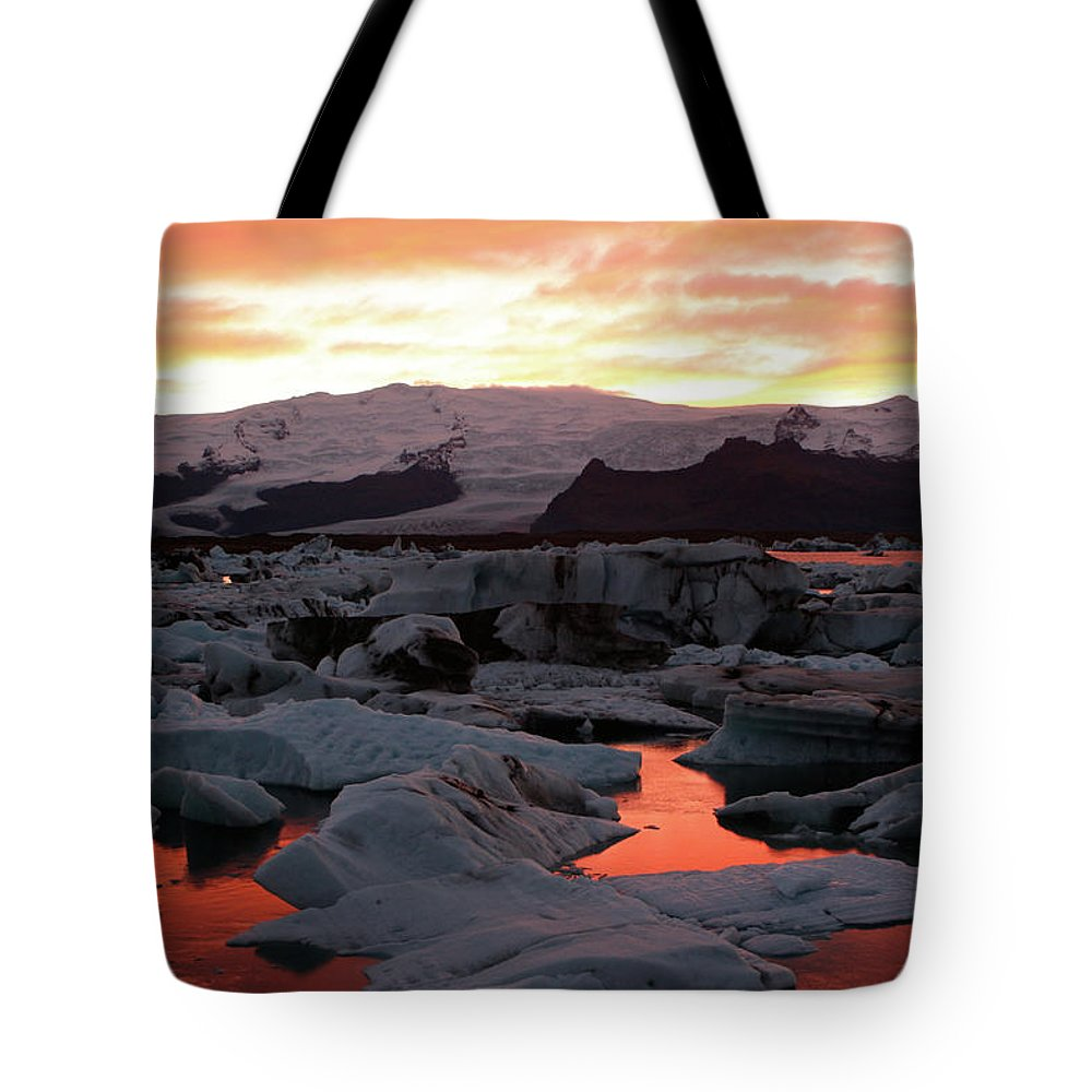 Scenics Tote Bag featuring the photograph Jokulsarlon Lagoon At Sunset by Richard Collins