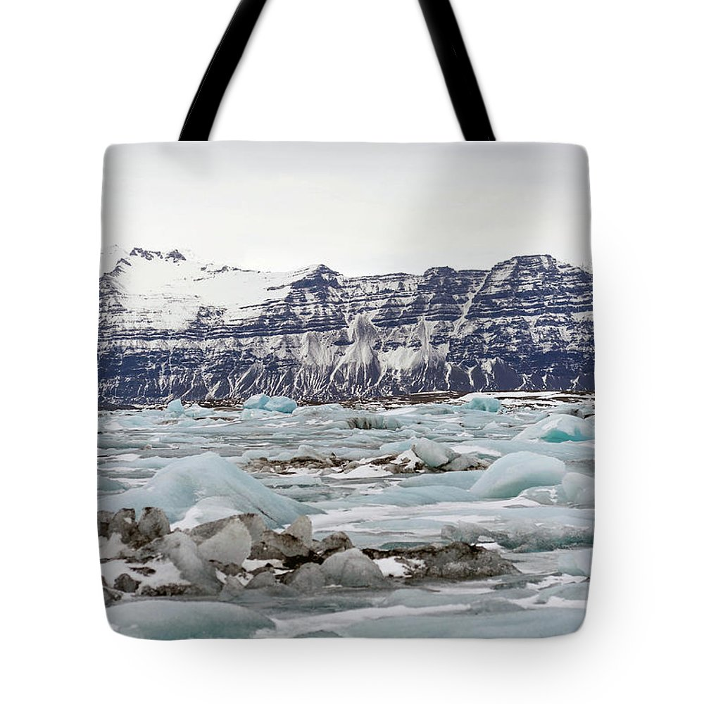 Tranquility Tote Bag featuring the photograph Jokulsarlon by Photo By Dave Moore