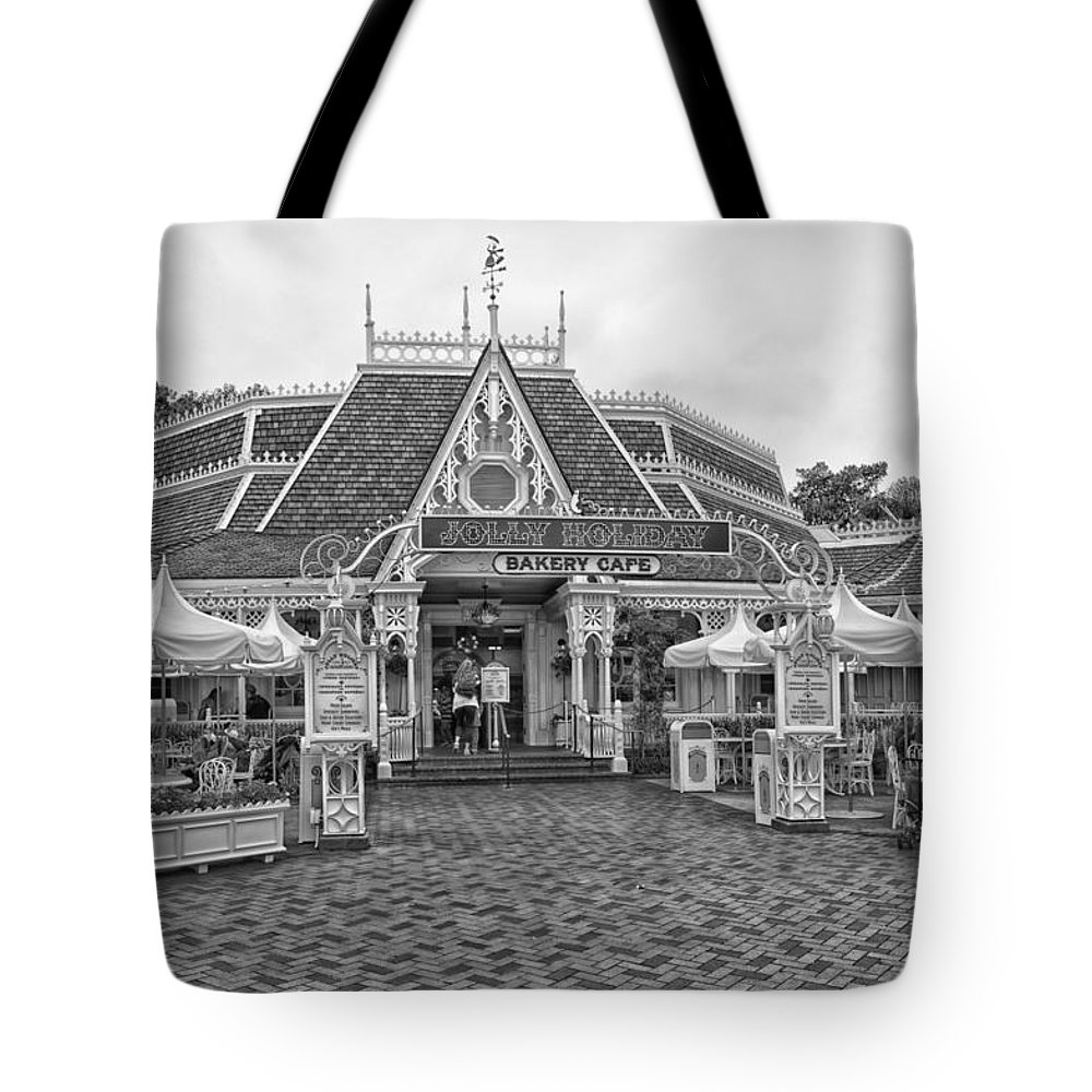 Disney Tote Bag featuring the photograph Jolly Holiday Cafe Main Street Disneyland Bw by Thomas Woolworth