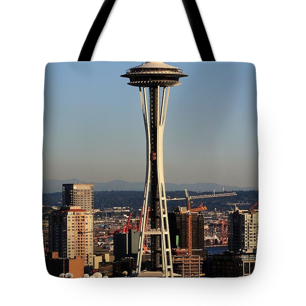 Space Needle Tote Bag featuring the photograph July 4th Needle by Benjamin Yeager