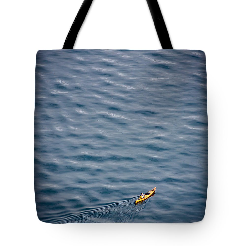 Kayak Tote Bag featuring the photograph Kayaking Alone by Mike Penney