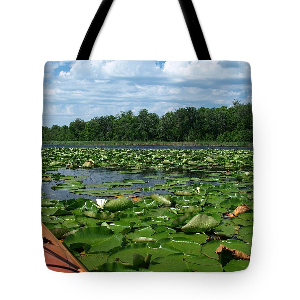 Nature Tote Bag featuring the photograph Kayaking Among The Waterlillies by James Peterson