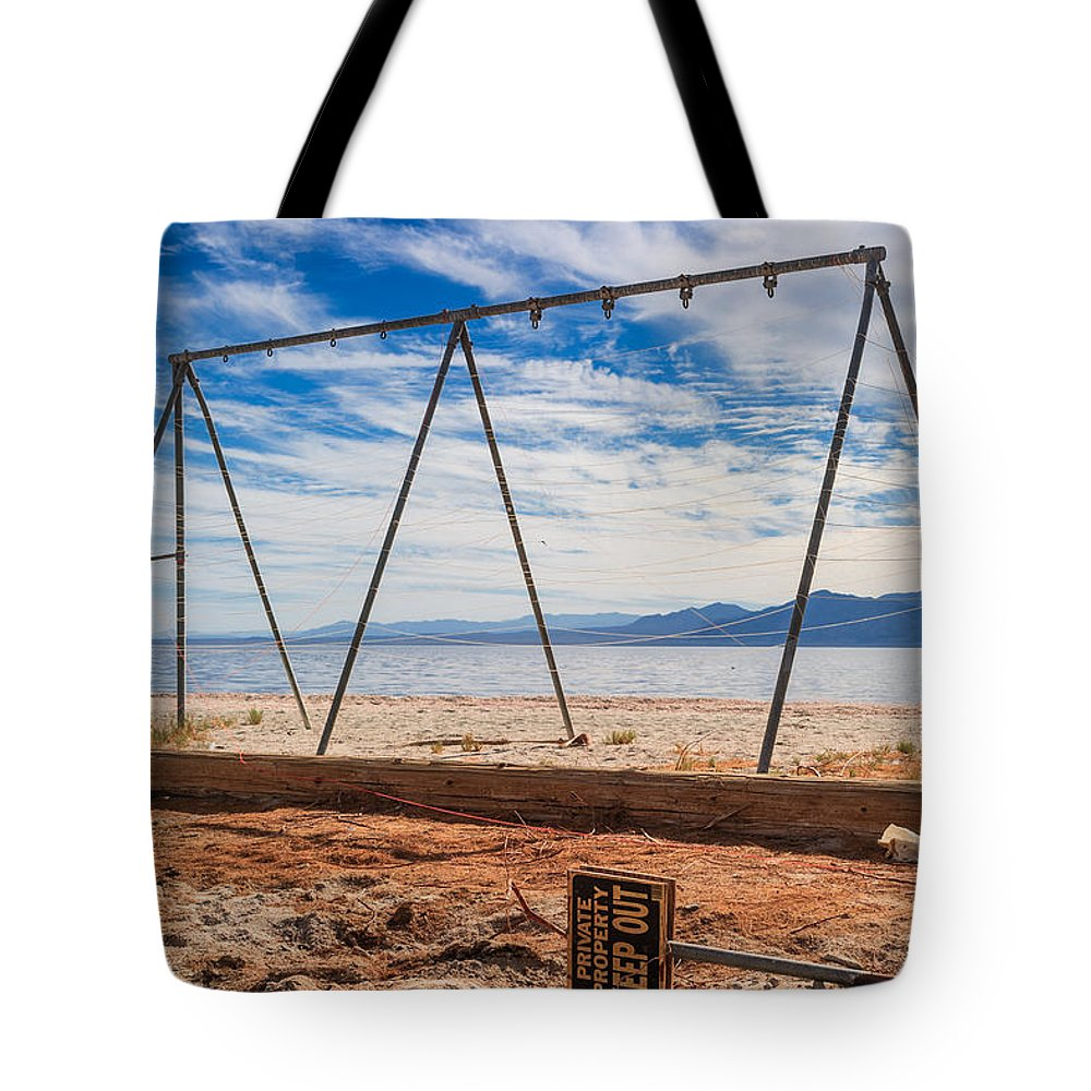 Salton Sea Tote Bag featuring the photograph Keep Out No Playing Here Swing Set Playground by Scott Campbell