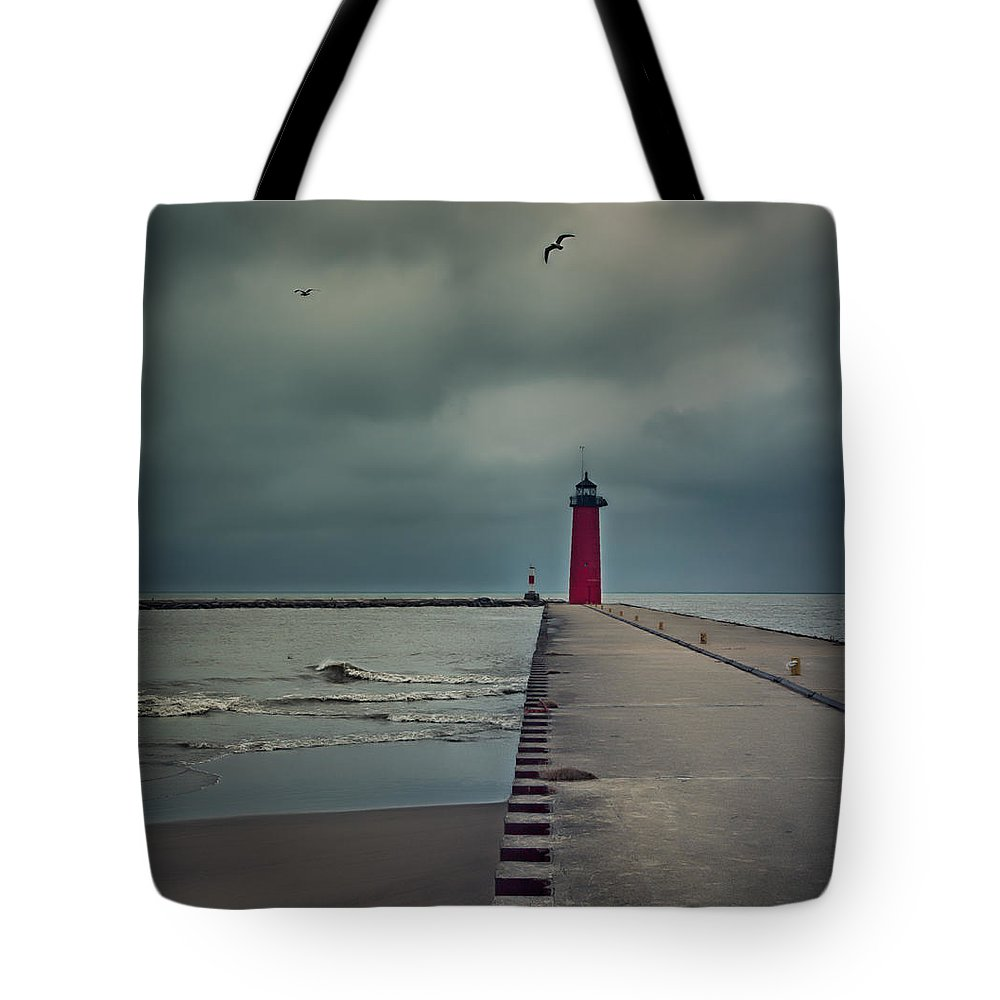 Lighthouse Tote Bag featuring the photograph Kenosha North Pier Lighthouse - Dark And Stormy by Martin Belan