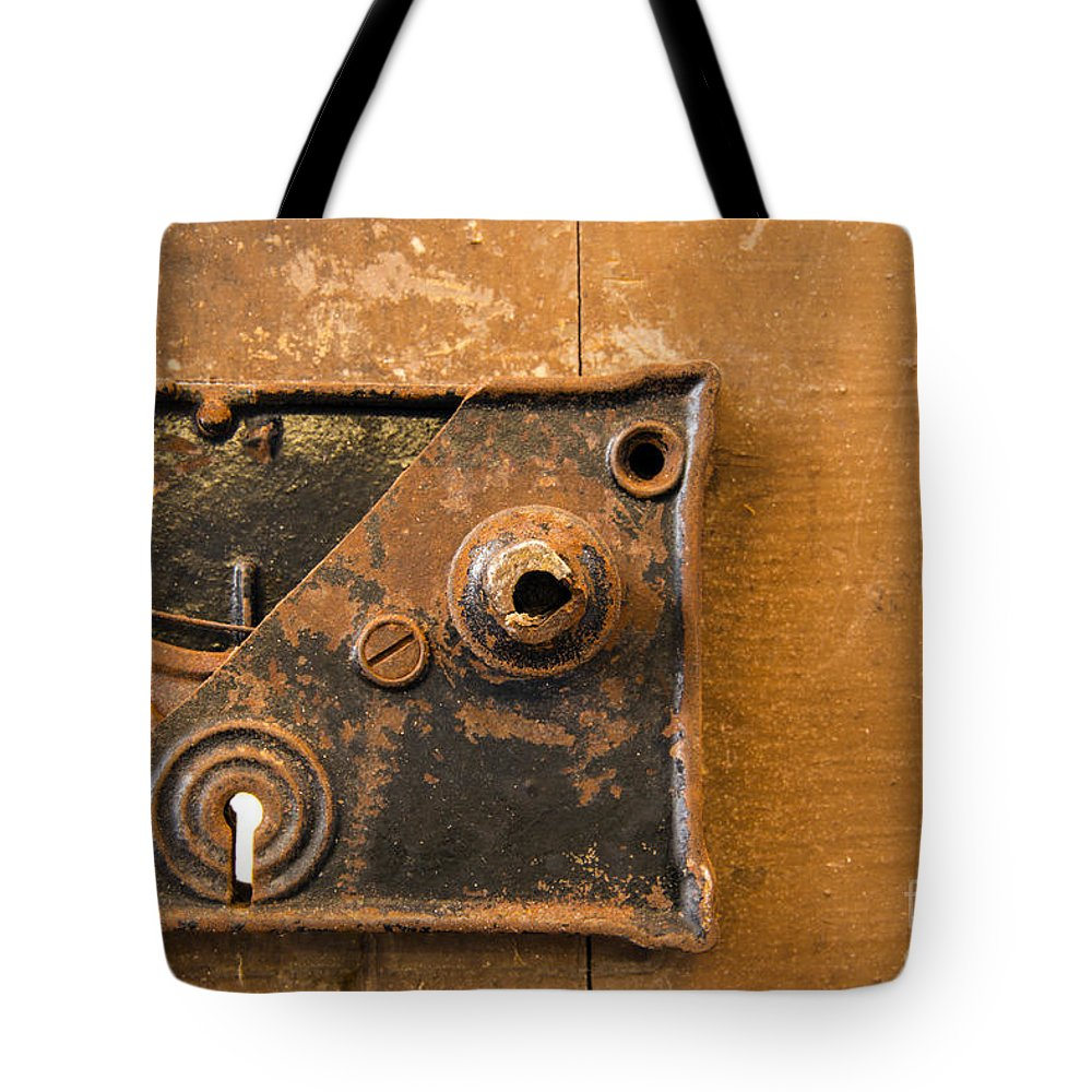 Lock Mechanism Tote Bag featuring the photograph Keyhole     by Bob Phillips