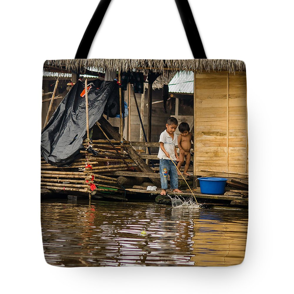 Peru Tote Bag featuring the photograph Kids At Play In Shanty Town by Allen Sheffield