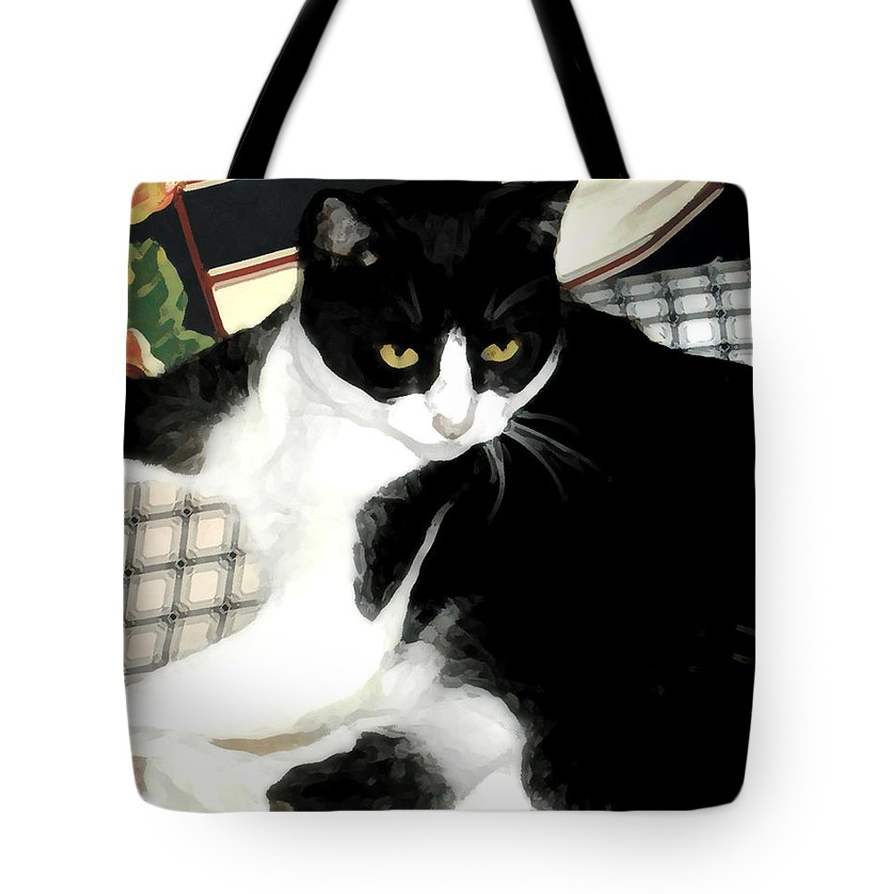 Black And White Tote Bag featuring the photograph Kitty On His Perch by Jeanne A Martin