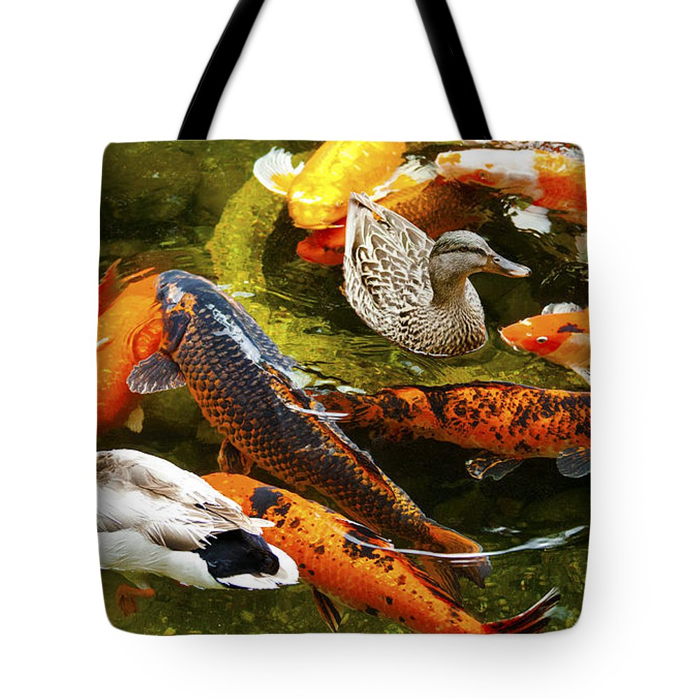 Koi Fish Photographs Tote Bag featuring the photograph Koi Fish In Pond Swimming With Two Mallard Ducks by Jerry Cowart