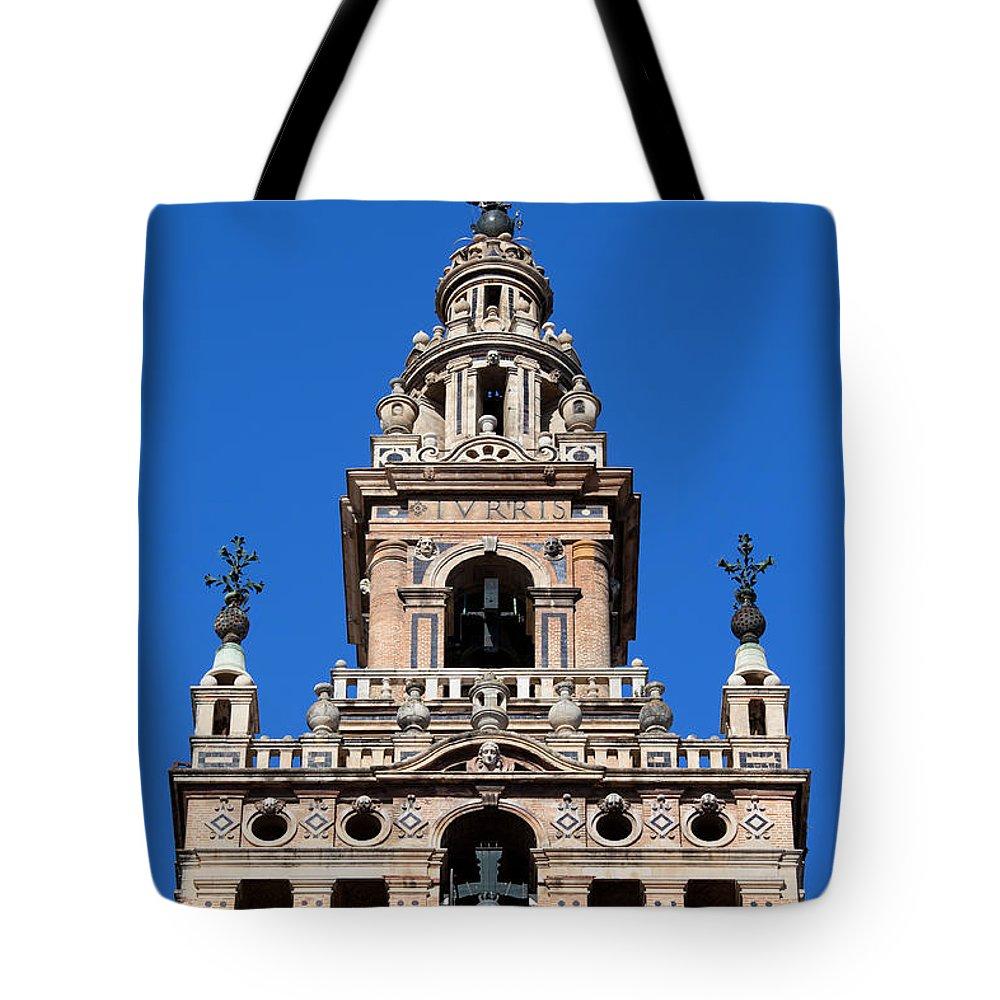 La Tote Bag featuring the photograph La Giralda Belfry In Seville by Artur Bogacki