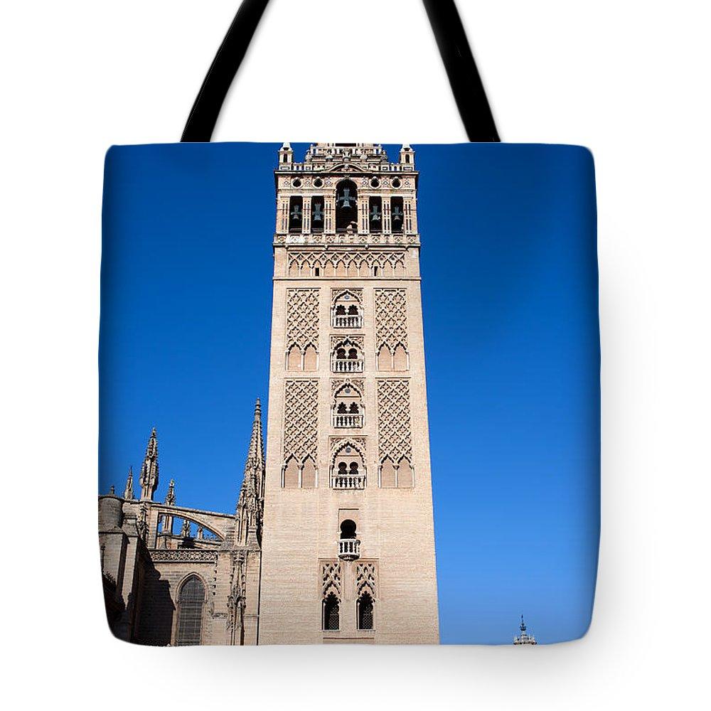 La Tote Bag featuring the photograph La Giralda Bell Tower In Seville by Artur Bogacki