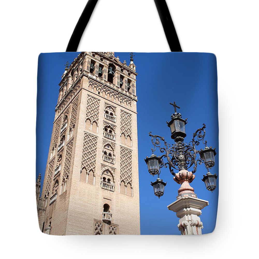 La Tote Bag featuring the photograph La Giralda Cathedral Tower In Seville by Artur Bogacki