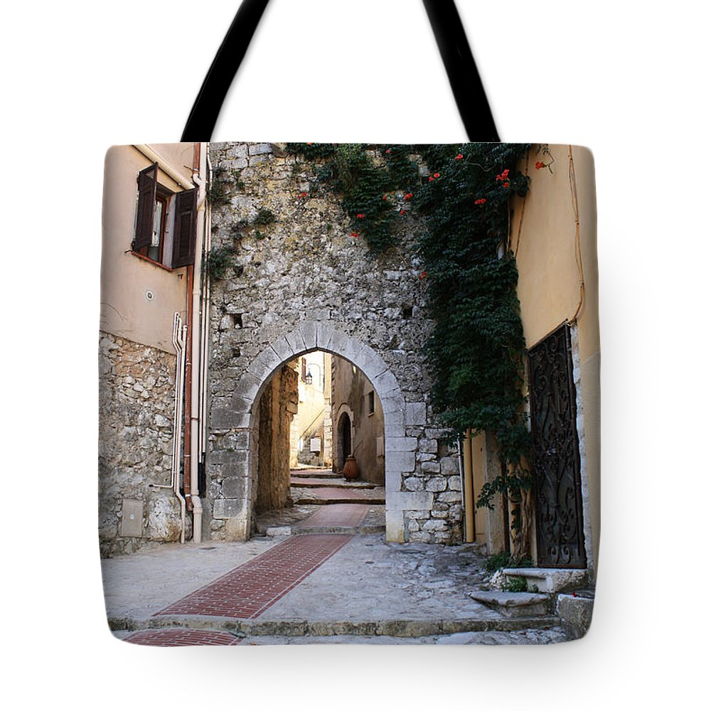 La Turbie Tote Bag featuring the photograph La Turbie French Village 4 by Bridget Brummel