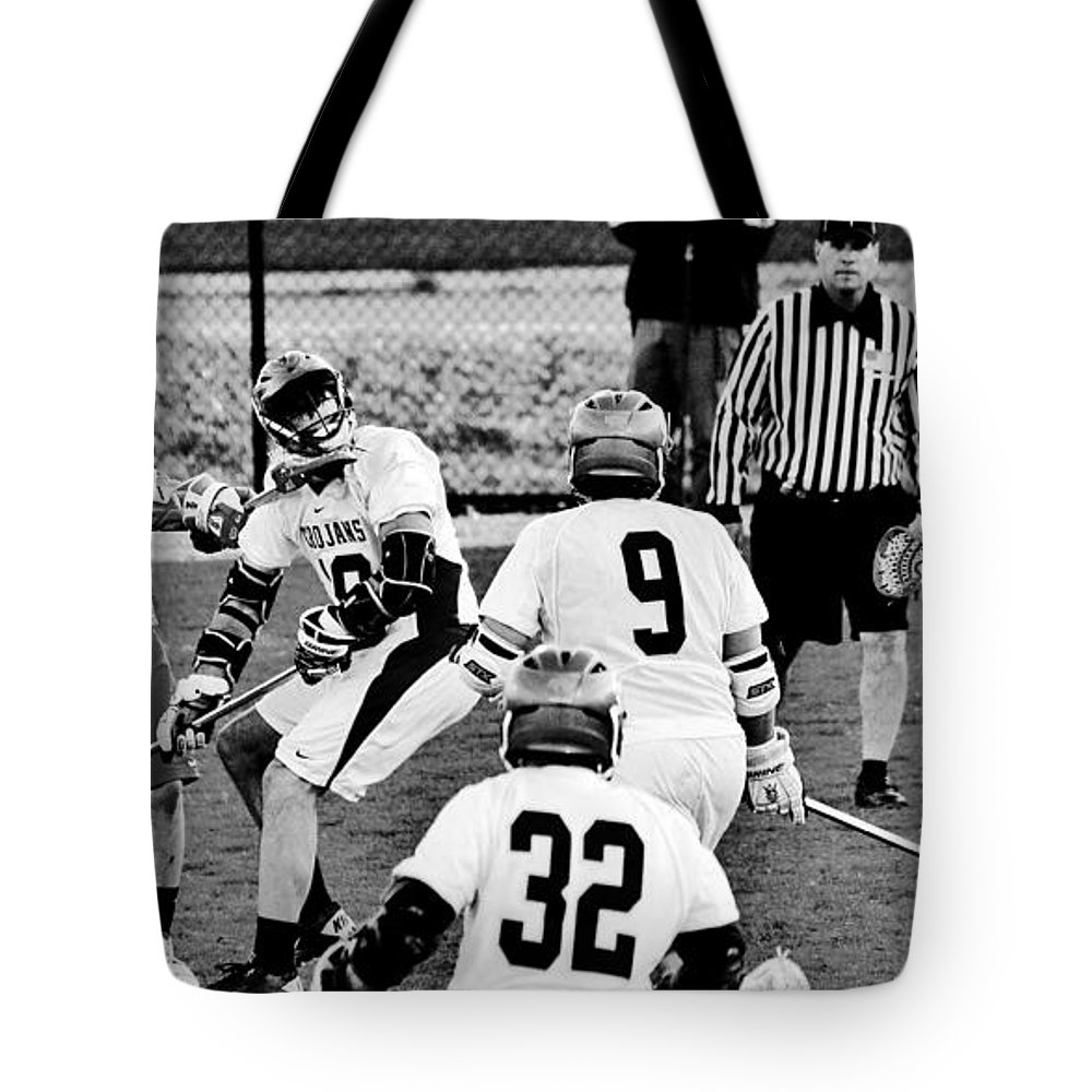 Lacrosse Tote Bag featuring the photograph Lacrosse - Stick To The Face by Benjamin Yeager