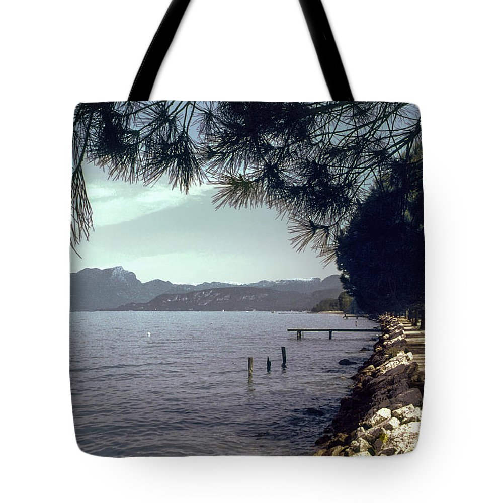 Lakes Garda Mountain Mountains Water Tree Trees Rock Rocks Landscape Landscapes Italy Waterscape Waterscapes Tote Bag featuring the photograph Lake Garda by Bob Phillips