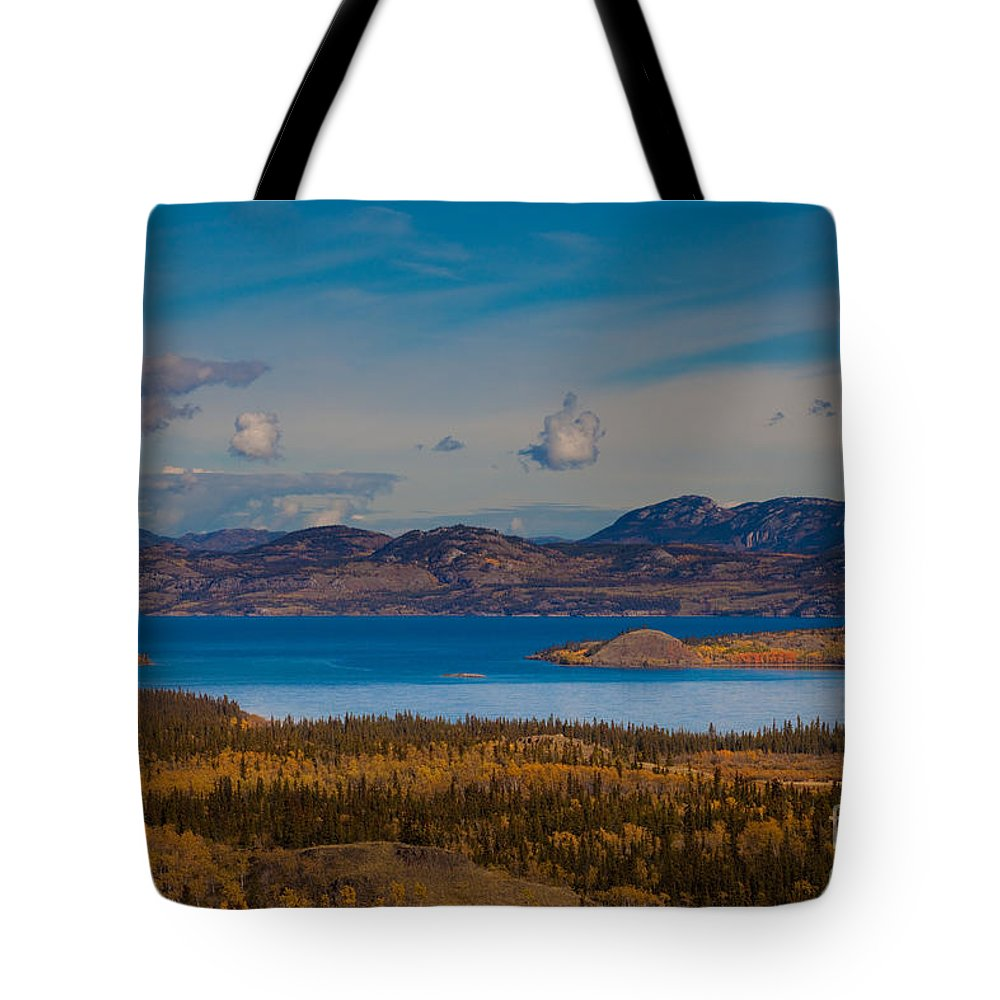 Autumn Tote Bag featuring the photograph Lake Laberge And Surrounding Taiga In Fall by Stephan Pietzko