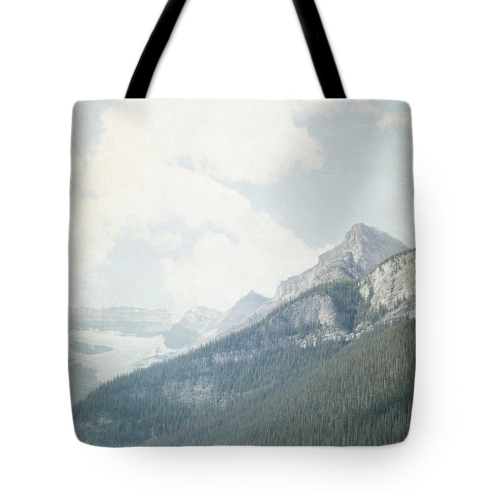 Rustic Wall Art Tote Bag featuring the photograph Lake Louise Solitude - Alberta Canada by Lisa Parrish