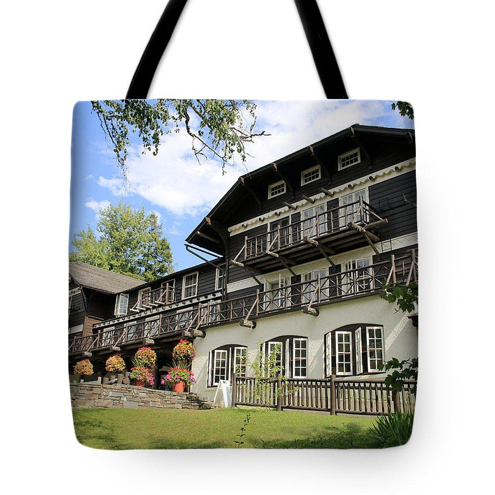 Lake Mcdonald Lodge Tote Bag featuring the photograph Lake Mcdonald Lodge by Nina Prommer