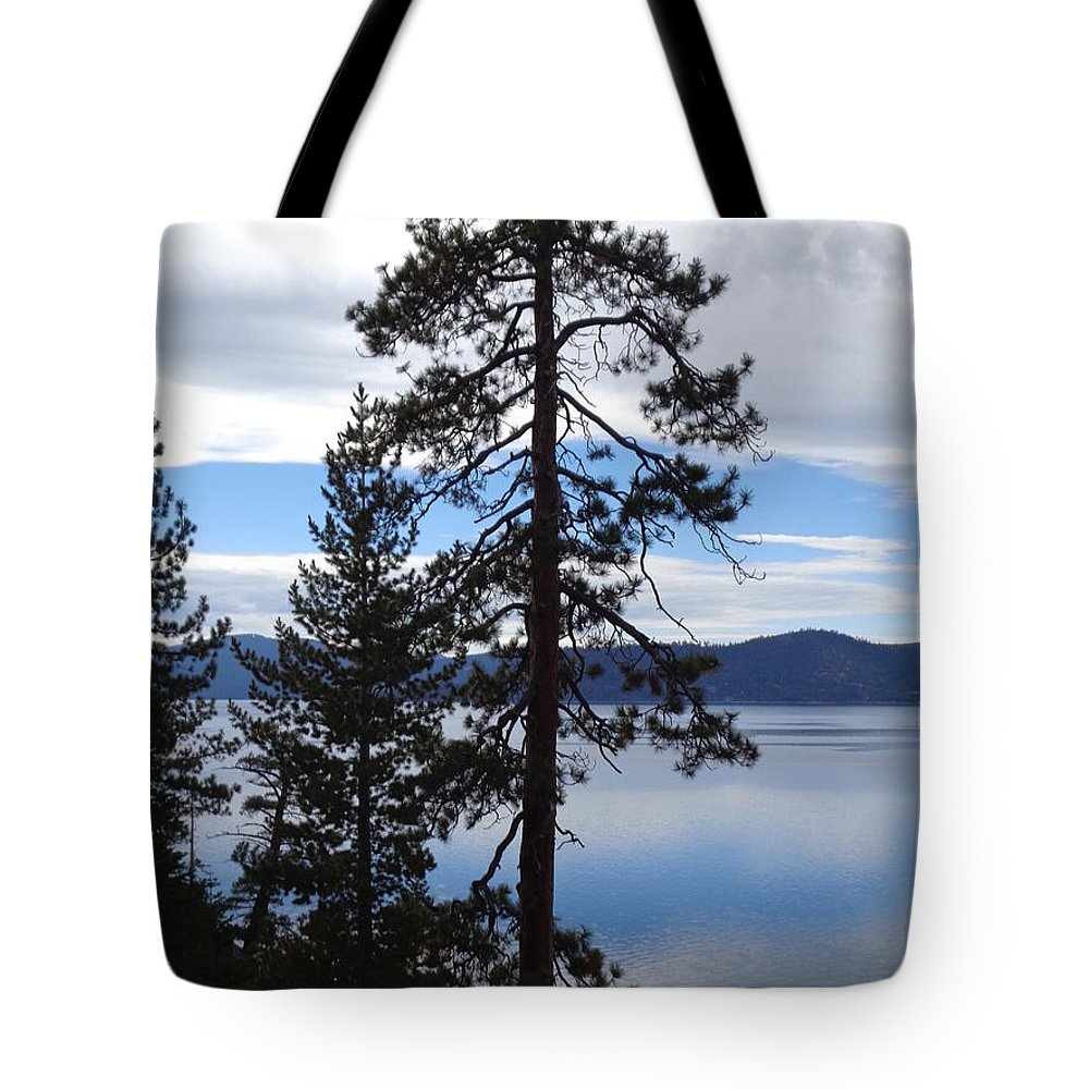 It Was A Cloudy Late Afternoon At Lake Tahoe. The Sky Made The Most Amazing Reflection Of Bright Blue On The Water Tote Bag featuring the photograph Lake Reflections At Tahoe by Kristina Lammers