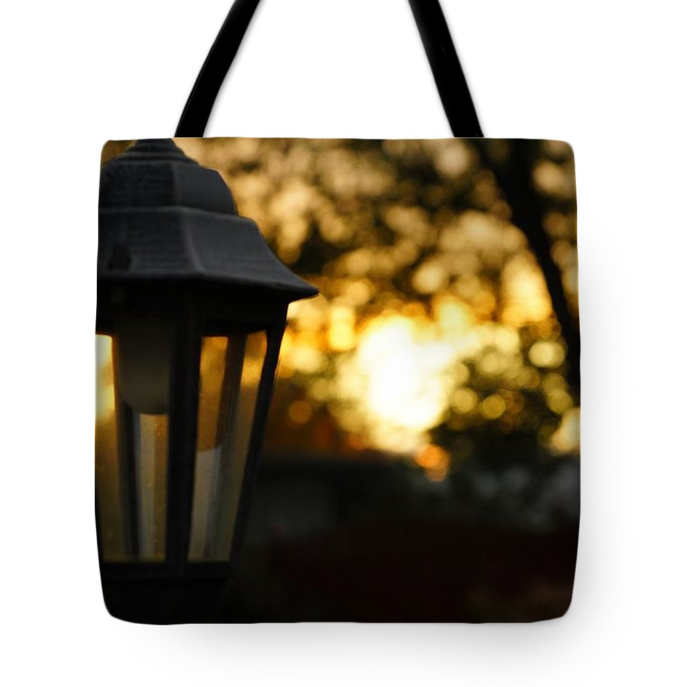 Lamp Tote Bag featuring the photograph Lamplight by Photographic Arts And Design Studio