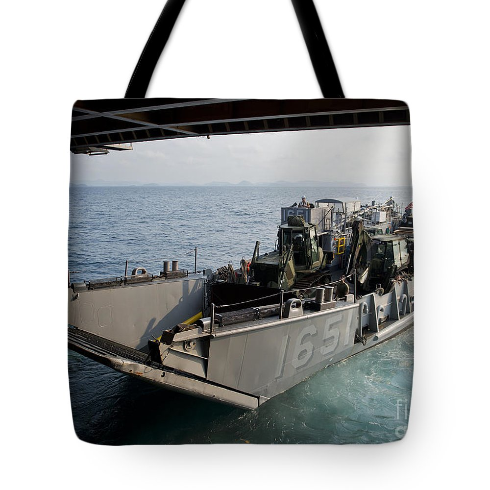 Military Tote Bag featuring the photograph Landing Craft Utility Departs The Well by Stocktrek Images