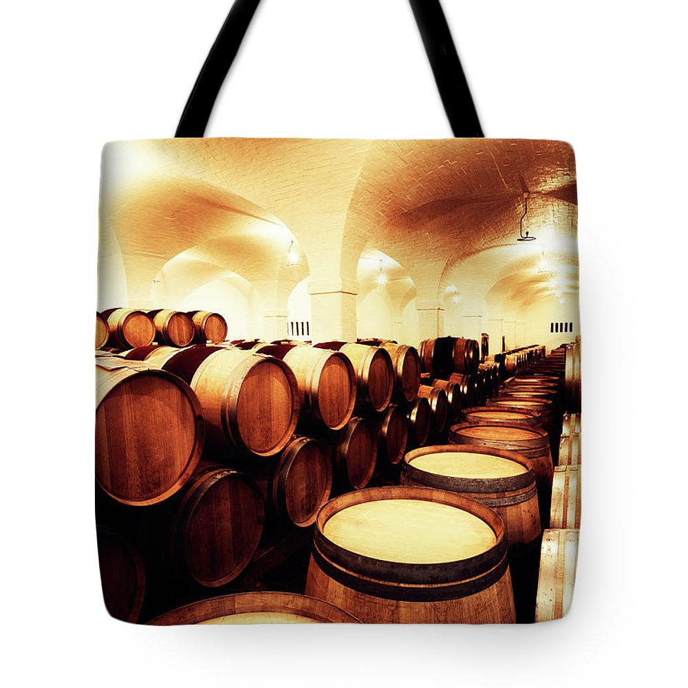 Alcohol Tote Bag featuring the photograph Large Winery Cellar Filled With Oak by Rapideye