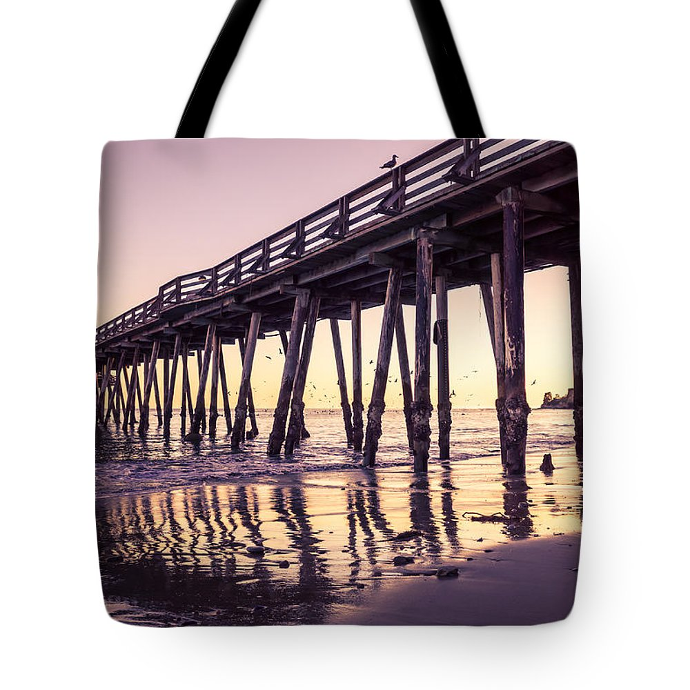 Capitola Tote Bag featuring the photograph Last Light At The Capitola Wharf by Priya Ghose
