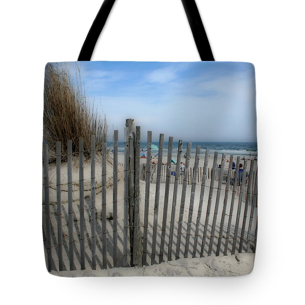 Landscapes Beach Art Sand Art Fence Wood Sky Blue Summertime Ocean Tote Bag featuring the photograph Last Summer by Linda Sannuti