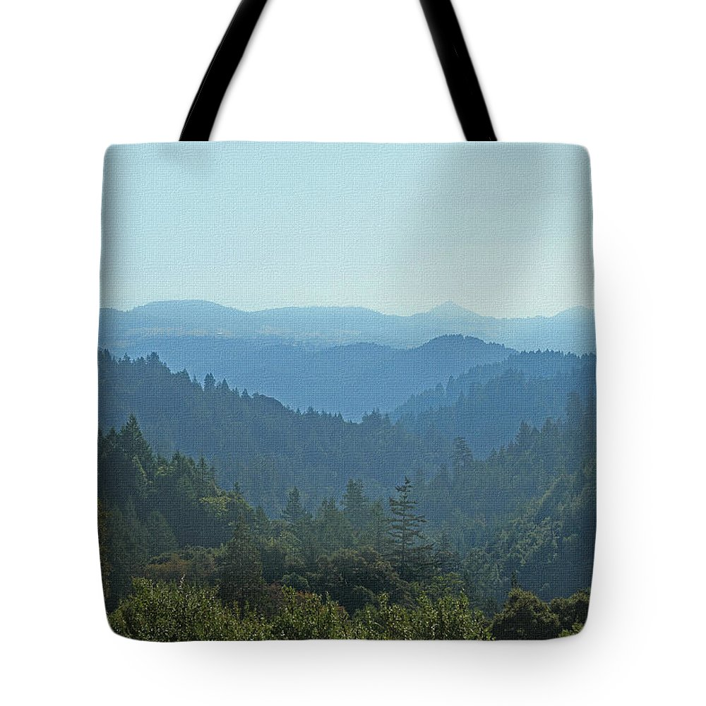 Layers Of Forest And Bllue Sky Tote Bag featuring the photograph Layers Of Forest And Bllue Sky by Tom Janca