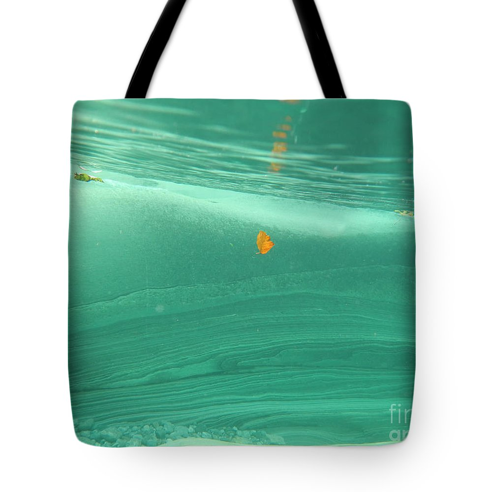 Leaf Tote Bag featuring the photograph Leaf Floating Underwater by Mats Silvan