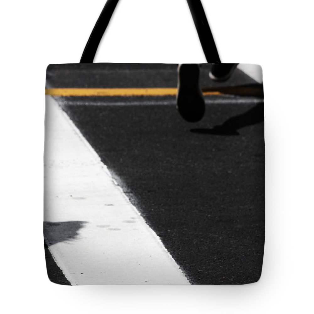 Street Photography Tote Bag featuring the photograph Leaving Leaps by The Artist Project
