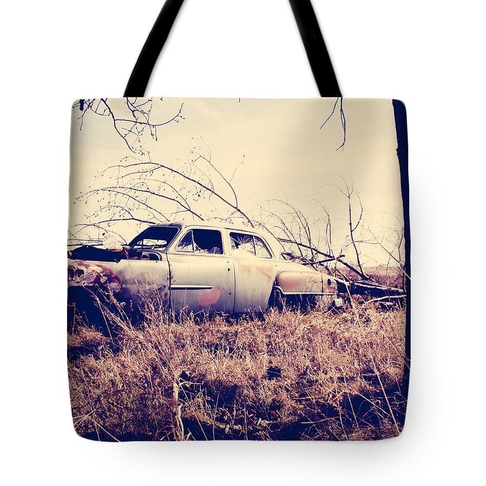 Old Car Tote Bag featuring the photograph Left Running by The Artist Project