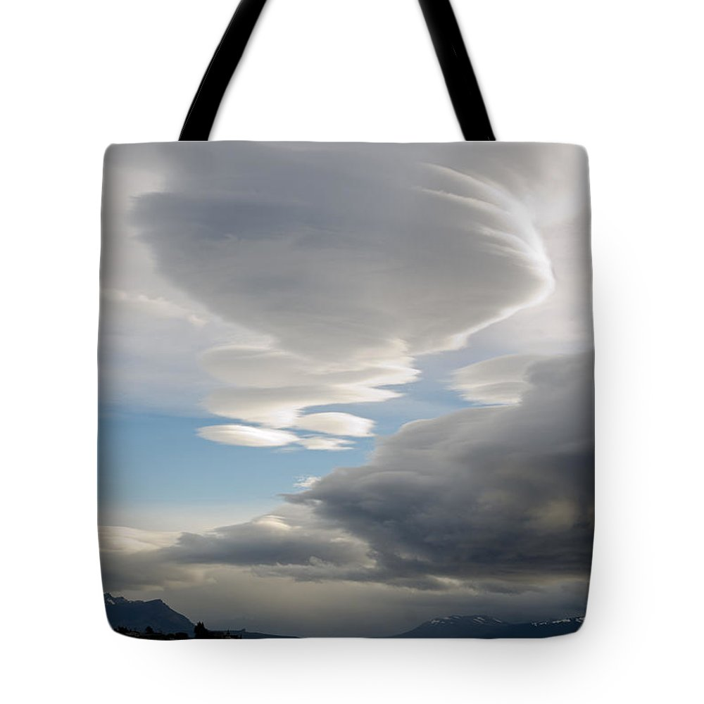 Puerto Natales Tote Bag featuring the photograph Lenticular Cloud Over Puerto Natales by Ralf Broskvar