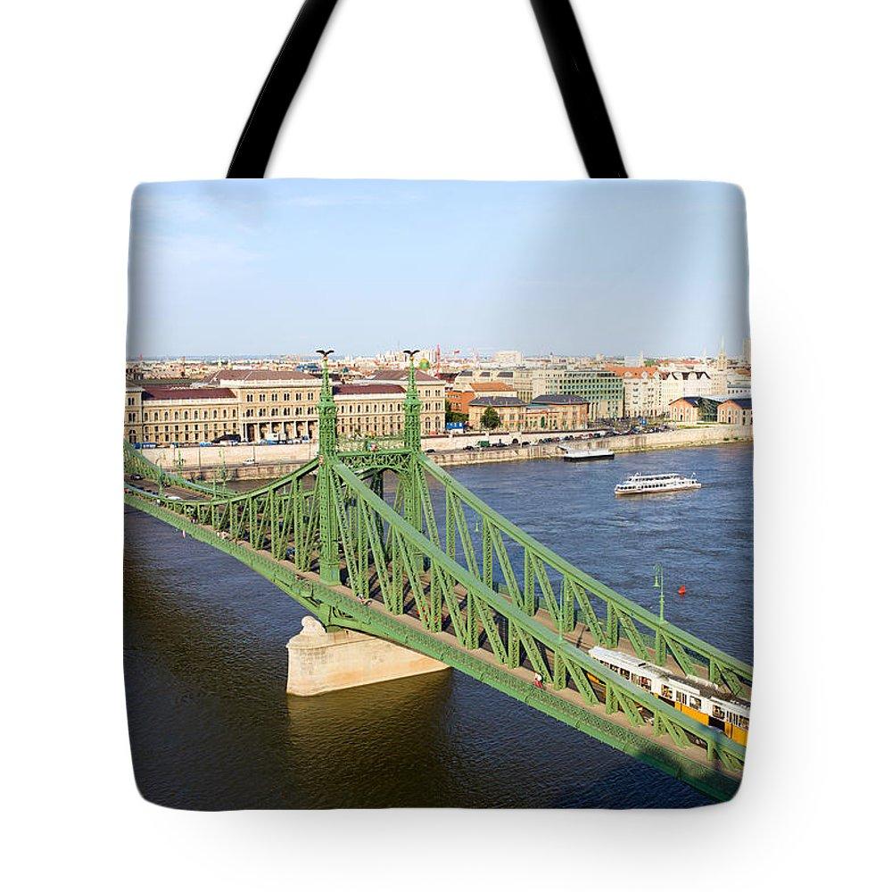 Budapest Tote Bag featuring the photograph Liberty Bridge And Budapest Skyline by Artur Bogacki