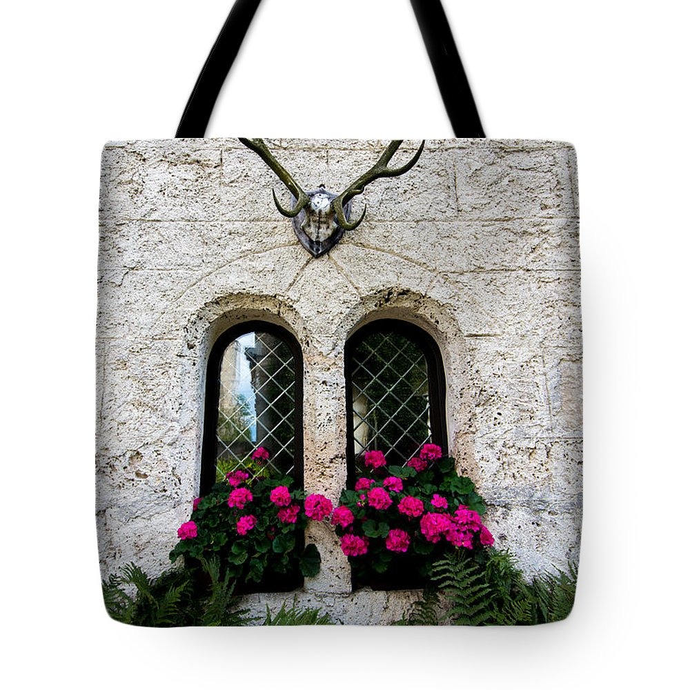 Lichtenstein Castle Tote Bag featuring the photograph Lichtenstein Castle Windows Wall And Antlers - Germany by Gary Whitton