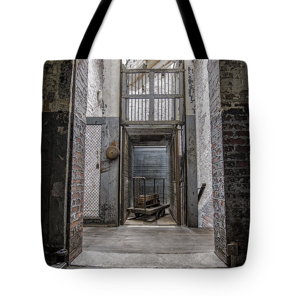 Urbex Tote Bag featuring the photograph Lifted by Rob Dietrich
