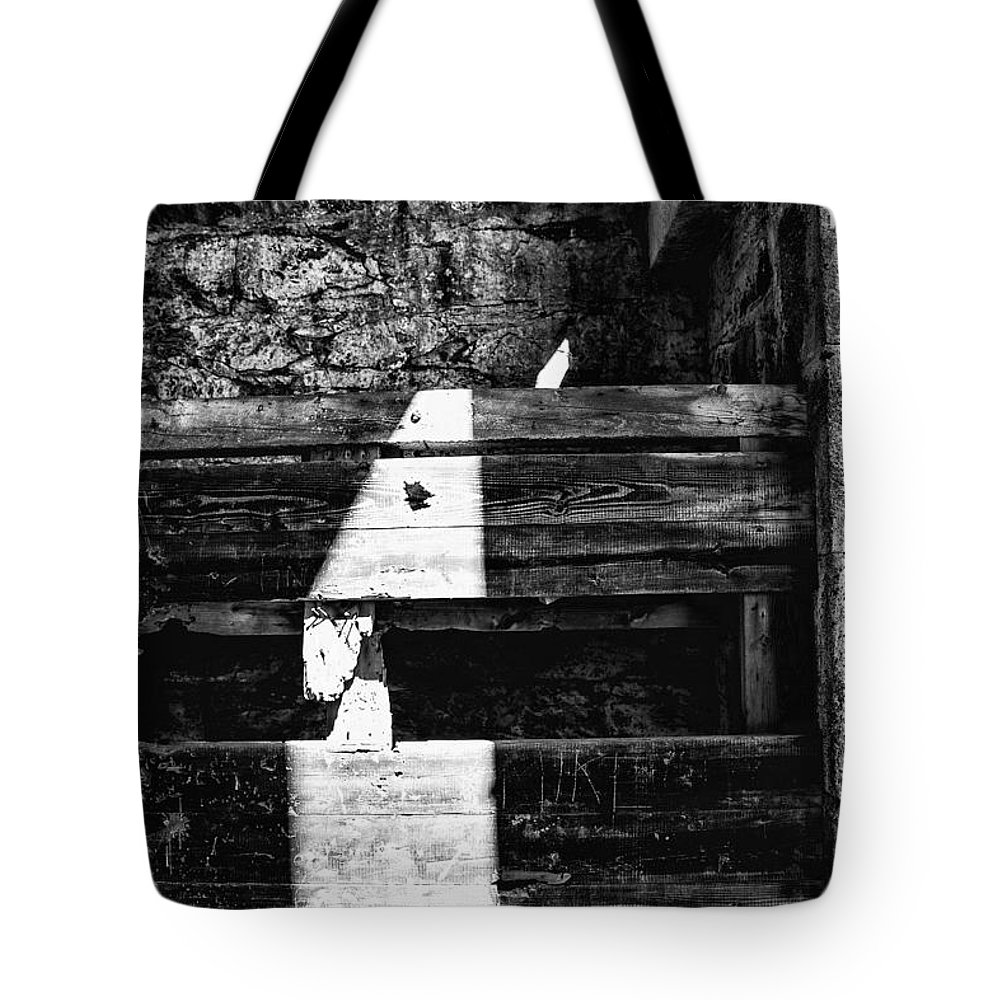 Light Finds A Way Tote Bag featuring the photograph Light Finds A Way by Karol Livote