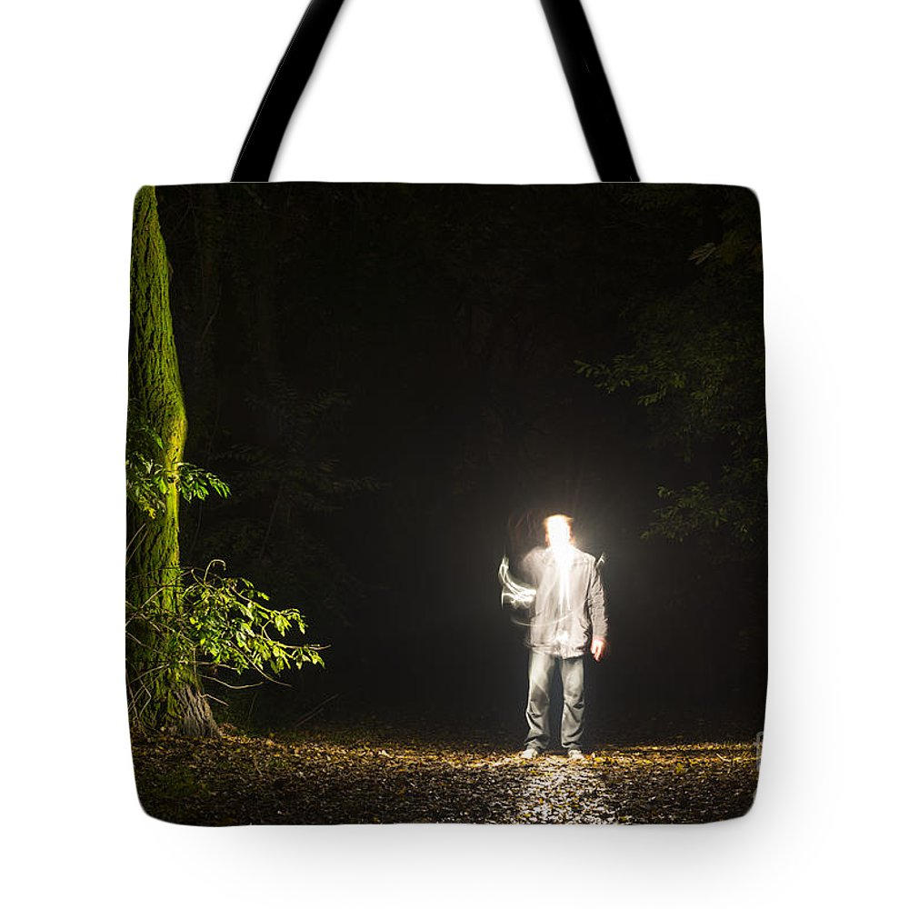 Man Tote Bag featuring the photograph Light Man by Mats Silvan