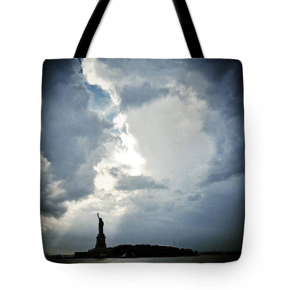 Statue Of Liberty Tote Bag featuring the photograph Light Of Liberty by Natasha Marco