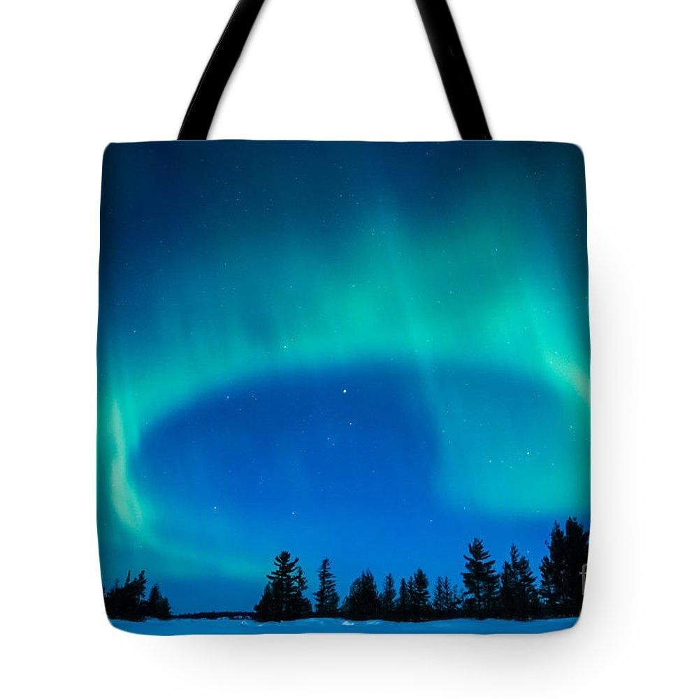 Aurora Borealis Tote Bag featuring the photograph Light Swirl On Rainy Lake by Lori Dobbs