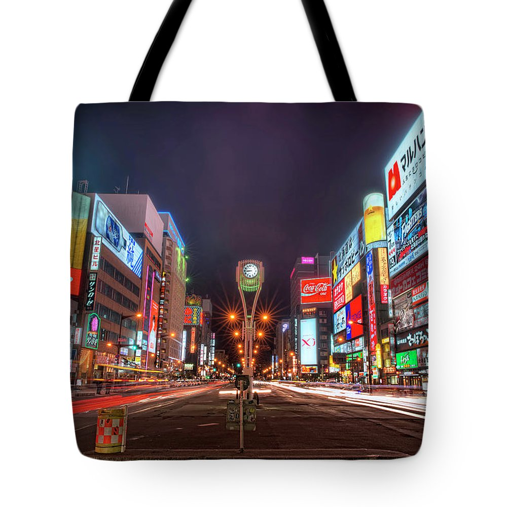 Hokkaido Tote Bag featuring the photograph Light Trails In Susukino by Daniel Chui