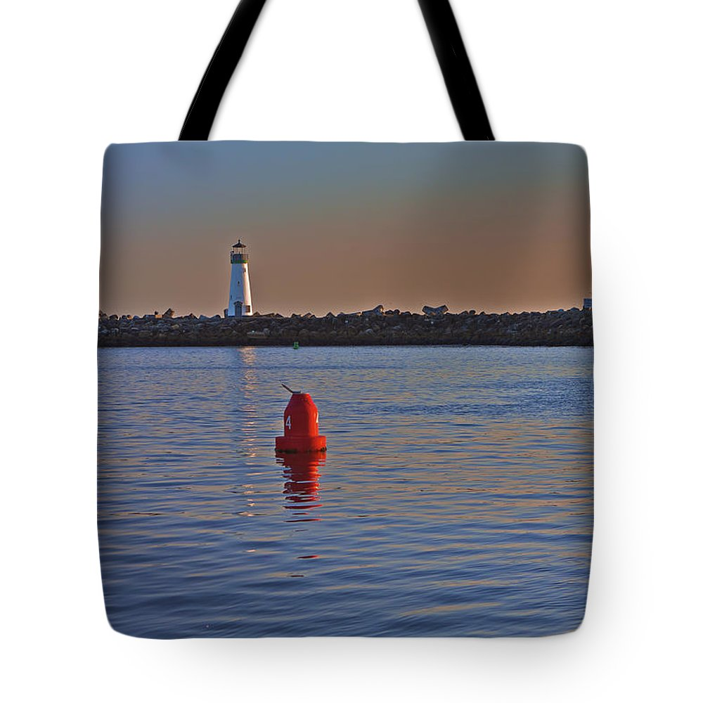Beach Tote Bag featuring the photograph Lighthouse At Harbor by SC Heffner