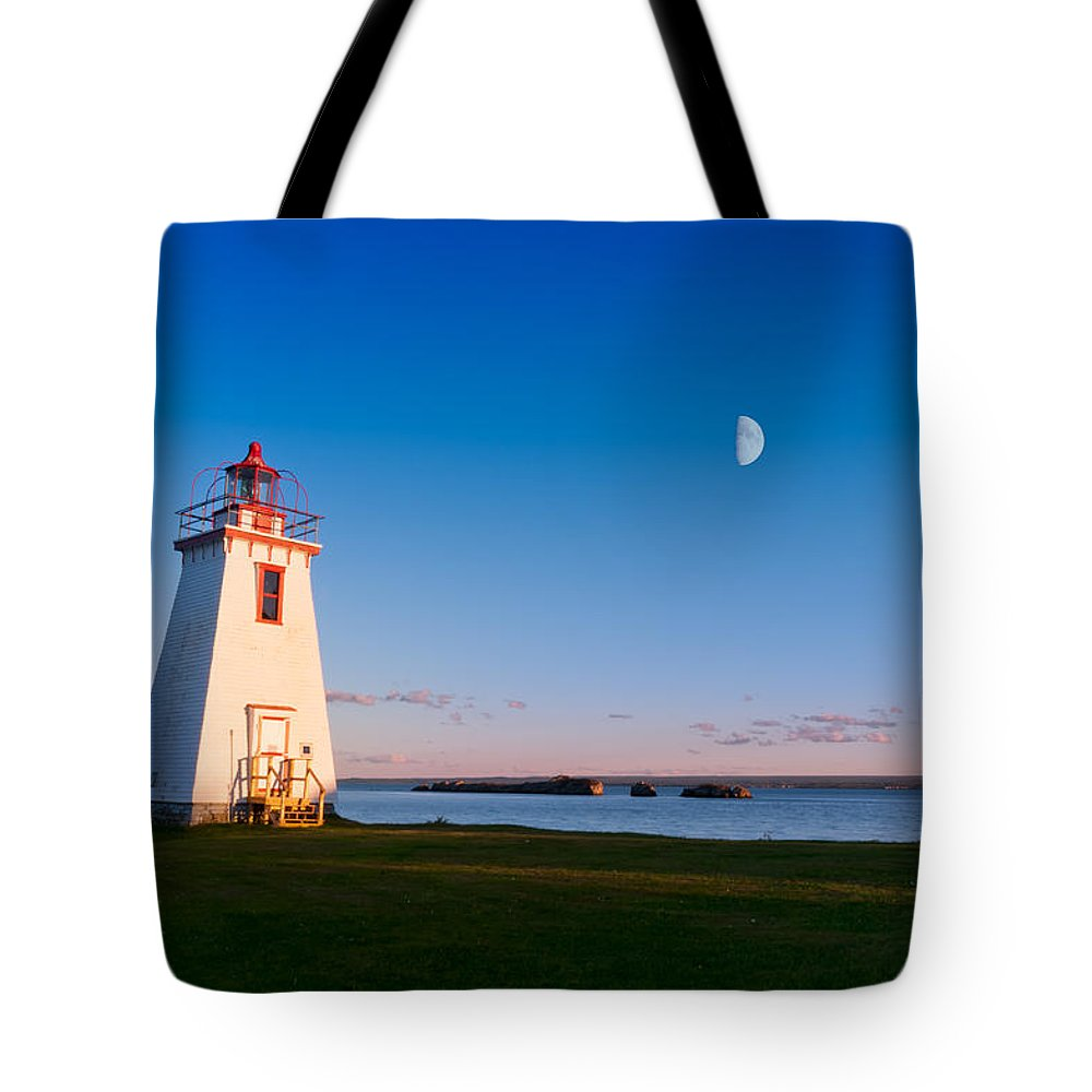 Beautiful Tote Bag featuring the photograph Lighthouse In The Light From Moon And Sun by U Schade