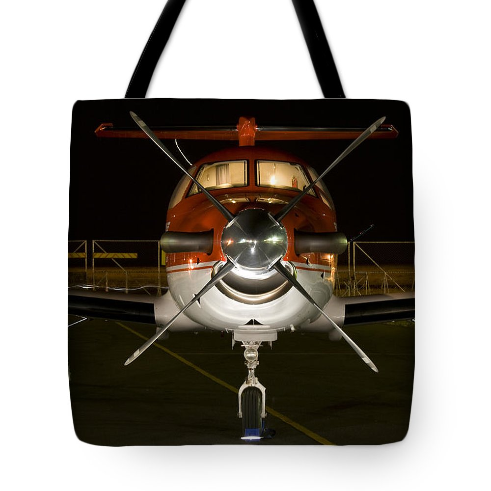 Pilatus Pc12 Golden Eagle Tote Bag featuring the photograph Lights On by Paul Job