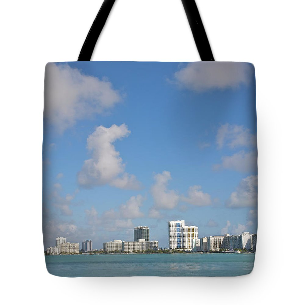 Residential District Tote Bag featuring the photograph Line Of White Residential Towers Above by Barry Winiker