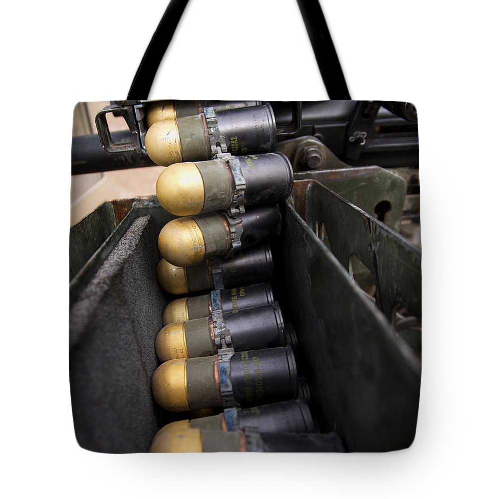 Operation Enduring Freedom Tote Bag featuring the photograph Linked 40mm Rounds Feed Into A Mark 19 by Stocktrek Images